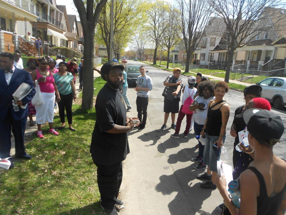 Members of the Black Love Matters Movement convene during a march through a north side neighborhood. (LaToya Dennis)
