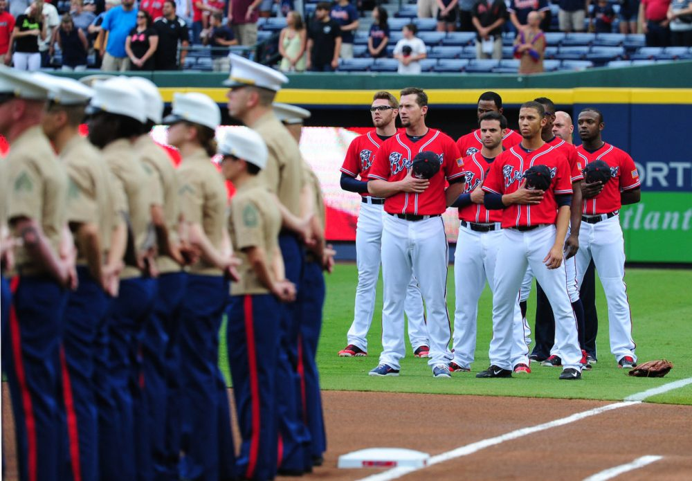 At Marines Military Appreciation Night, members of the Atlanta Braves stand to honor veterans at Turner Field. Did the military pay the Braves to do this, or was it out of the kindness of their heart? (Scott Cunningham/Getty Images)