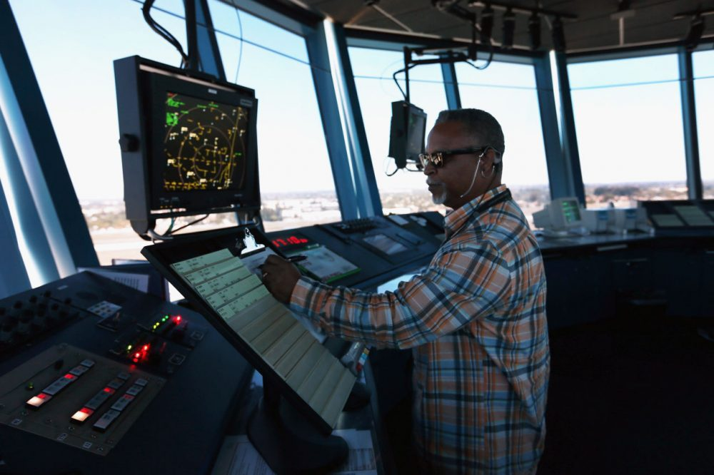 Air-traffic controller Robert Moreland works in the control tower at Opa-locka airport on March 4, 2013 in Opa-locka, Florida. (Joe Raedle/Getty Images)
