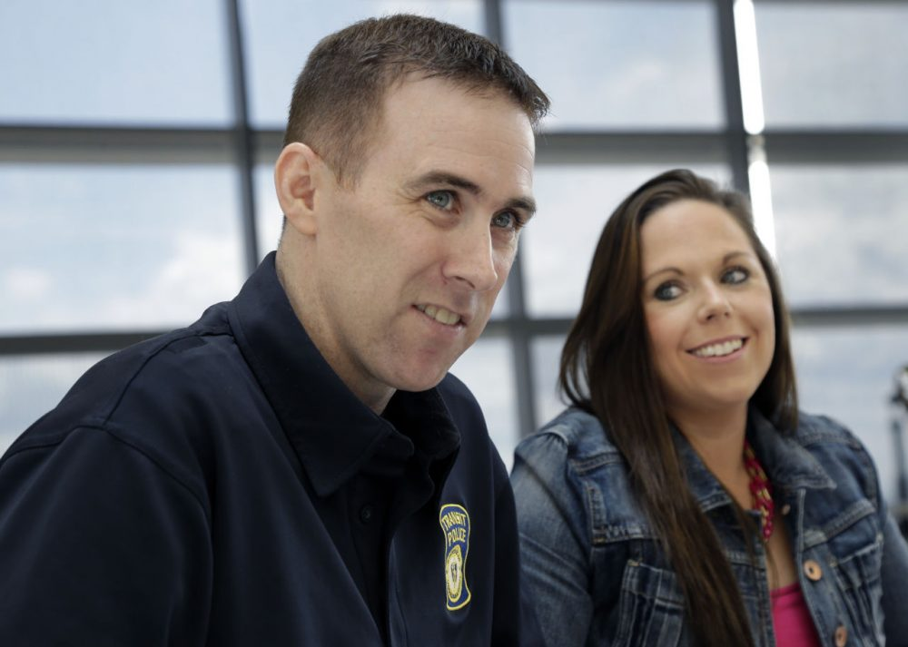 MBTA Police Officer Richard Donohue with his wife, Kim, in a 2013 file photo (Elise Amendola/AP)