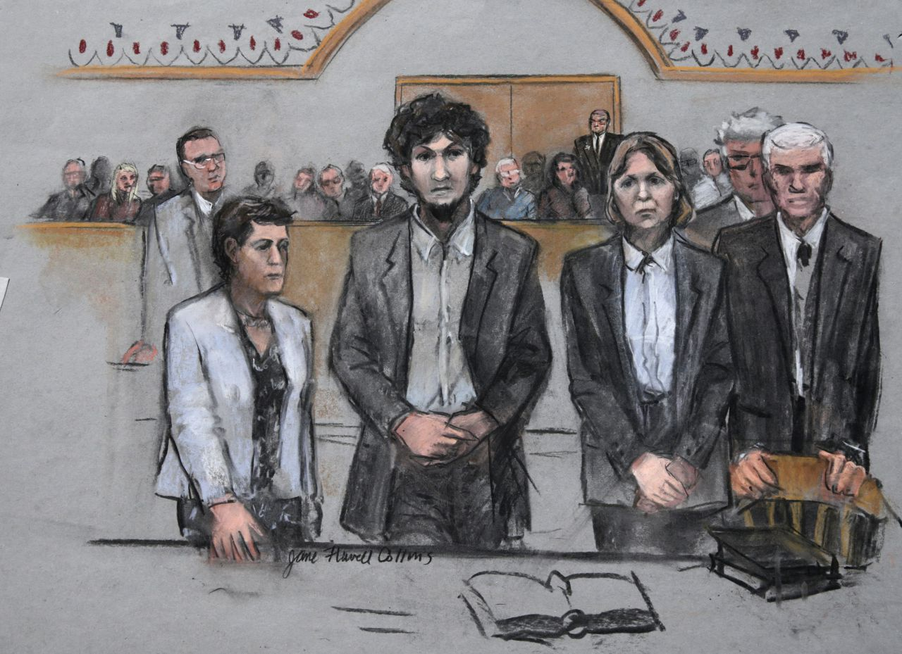In this courtroom sketch, Dzhokhar Tsarnaev stands with his defense attorneys as a death sentence is read at the Moakley federal courthouse in the penalty phase of his trial in Boston, Friday, May 15, 2015. (Jane Flavell Collins/AP)