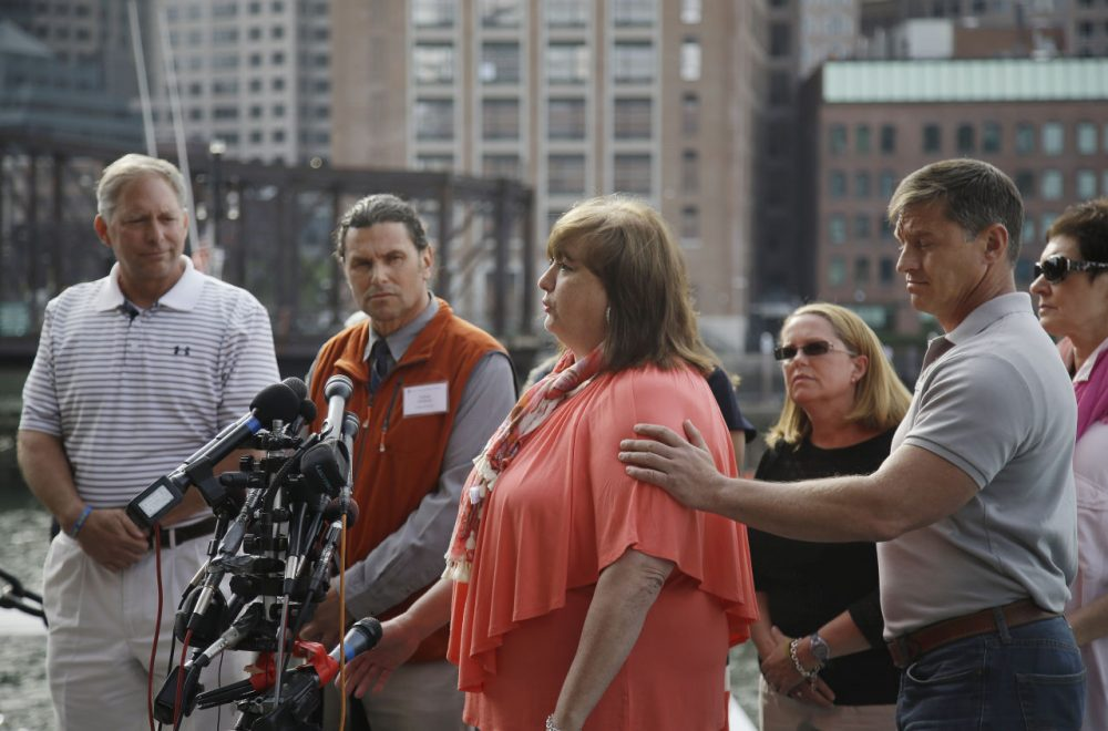 Liz Norden, whose two sons each lost a leg in the attack, speaks to media outside the courthouse and receives support from first responder Mike Ward. (Stephan Savoia/AP)