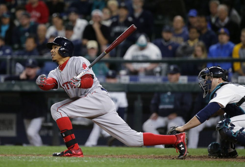 Boston Red Sox's Mookie Betts hits a sacrifice fly that allowed him to reach first base on a fielding error by Seattle Mariners left fielder Rickie Weeks in the ninth inning of a baseball game, Thursday, May 14, 2015, in Seattle. (Ted S. Warren/AP)