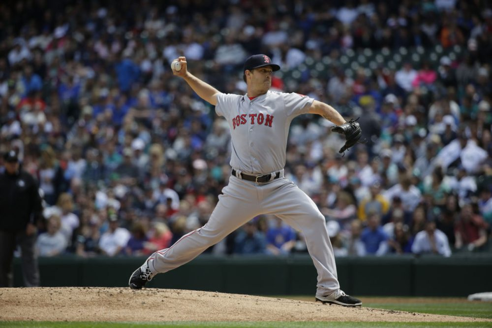 Starting pitcher Steven Wright throws against the Seattle Mariners in a baseball game, Sunday, May 17, 2015, in Seattle.