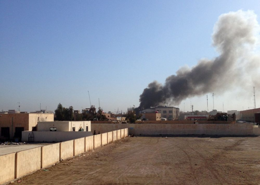 A picture taken on March 11, 2015 shows smoke billowing after the building of the Anbar Governorate was hit by a mortar shell in the Hosh district of Ramadi as the Islamic State jihadist group launched a coordinated attack on government-held areas of the western Iraqi city, involving seven almost simultaneous suicide car bombs, police said. (Azhar Shallal/AFP/Getty Images)