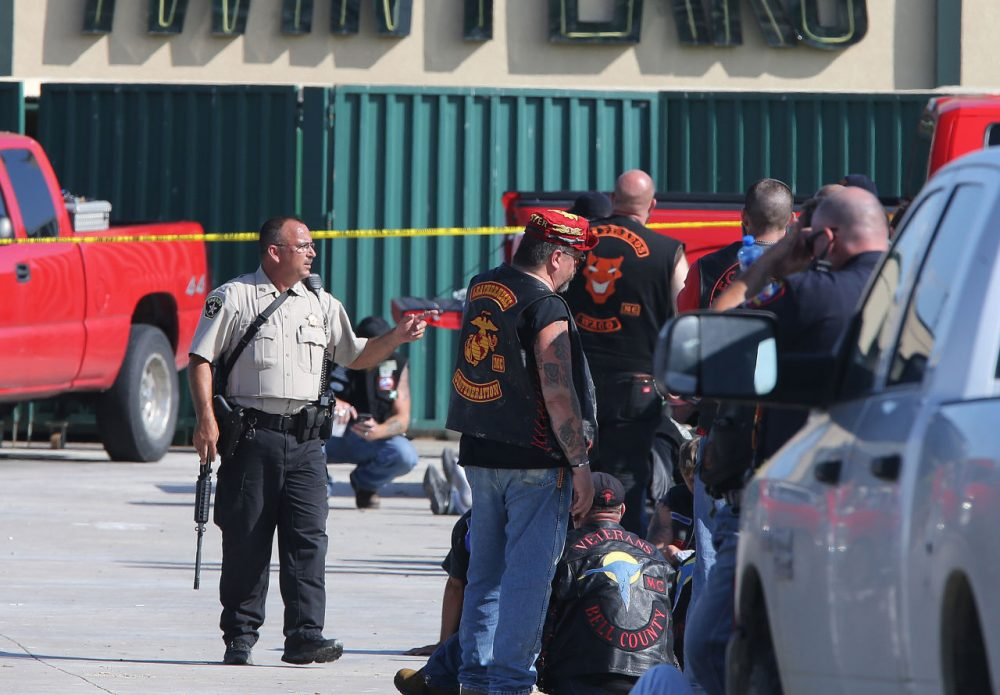 Authorities investigate a shooting in the parking lot of the Twin Peaks restaurant Sunday, May 17, 2015, in Waco, Texas. Authorities say that the shootout victims were members of rival biker gangs that had gathered for a meeting. (Jerry Larson/AP)