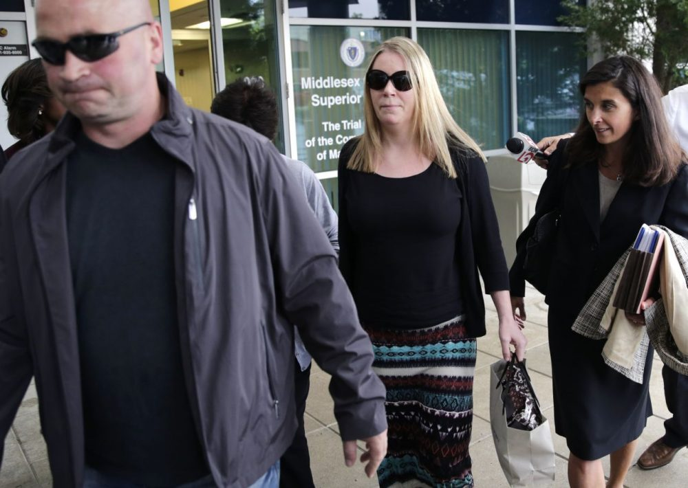 Aisling Brady McCarthy, center, leaves court with her attorney, Melinda Thompson, right, following a status hearing at Middlesex Superior Court in Woburn on Tuesday. McCarthy, a nanny from Ireland, is accused of killing a 1-year-old girl in her care two years ago. (Charles Krupa/AP)