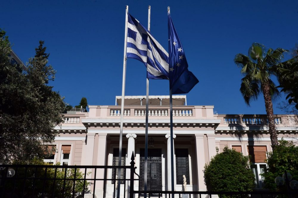 Greek and E.U. flags flutter in front of the prime minister's office in Athens during his meeting with top ministers on May 13, 2015. (Louisa Gouliamaki/AFP/Getty Images)