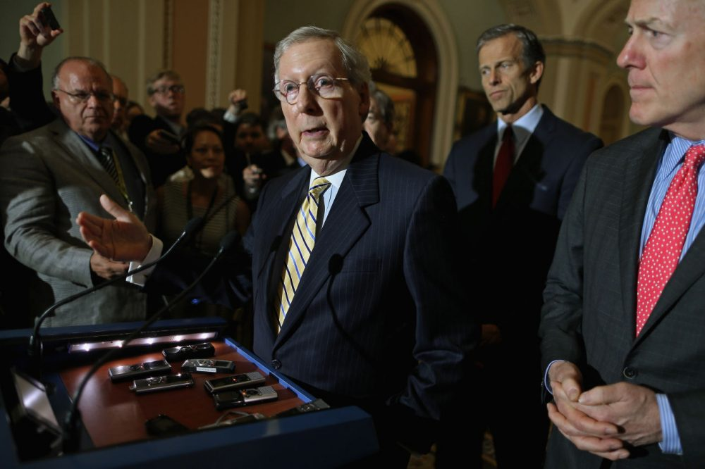 Senate Majority Leader Mitch McConnell (R-KY) talks to reporters with Sen. John Cornyn (R-TX) and Sen. John Thune (R-SD) after the weekly Senate GOP policy luncheon at the U.S. Capitol May 19, 2015 in Washington, D.C. Although he does not support the House version of the Patriot Act reauthorization, McConnell said the Senate would go forward with a vote on the legislation that would eliminate the bulk data collection programs, which were exposed by Edward Snowden. (Chip Somodevilla/Getty Images)