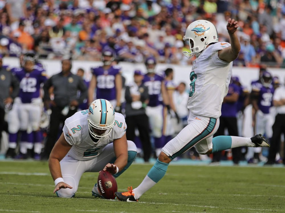 Kicker Caleb Sturgis #9 of the Miami Dolphins kicks an extra point as punter Brandon Fields holds during a game against the Minnesota Vikings at Sun Life Stadium on December 21, 2014 in Miami Gardens, Florida. (Rob Foldy/Getty Images)