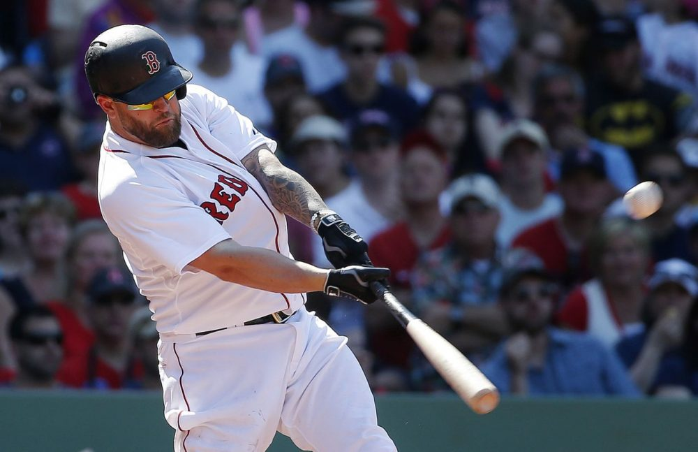 Boston Red Sox's Mike Napoli hits a two-run double during the eighth inning of a game against the Los Angeles Angels Sunday. (Michael Dwyer/AP)