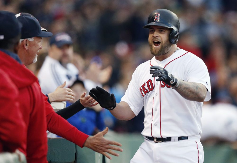 Red Sox's Mike Napoli, right, celebrates his solo home run during the second inning  against the Los Angeles Angels in Boston, Saturday, May 23, 2015. (AP Photo/Michael Dwyer)