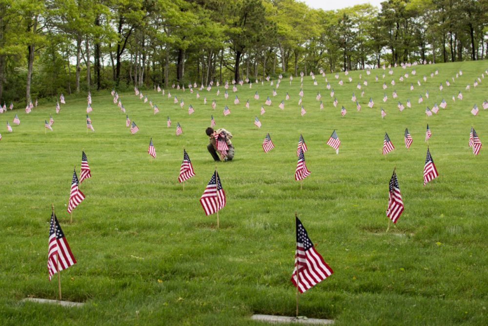 American flags mark the graves of veterans at Massachusetts National Cemetery during a past Operation Flags for Vets. (Casey Ashlock)