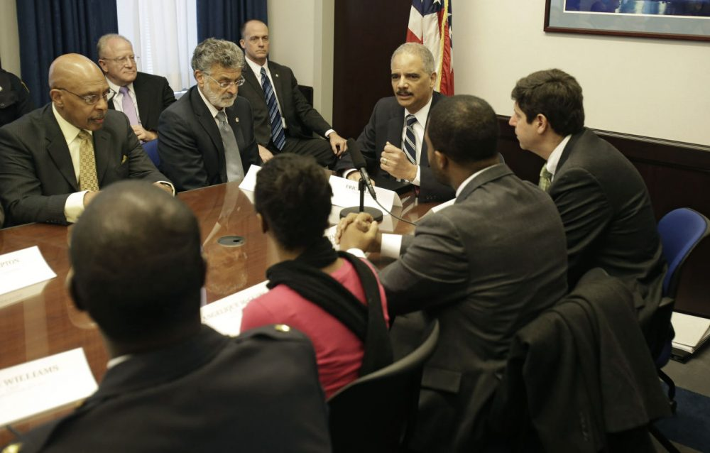 U.S. Attorney General Eric Holder holds a roundtable meeting with law enforcement, local officials, and community leaders to discuss the U.S. Department of Justice's report on excessive police force and violence in Cleveland, Dec. 4, 2014. Today, Cleveland waits for the Department of Justice's police statement. (Tony Dejak/AP)