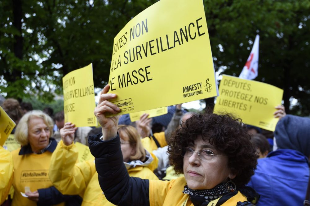 Protesters hold placards reading 'Say no to mass surveillance' take part on May 4, 2015 in Paris in a demonstration against the government's controversial bill giving spies sweeping new surveillance powers, deemed 'heavily intrusive' by critics. (Alain Jocard/AFP/Getty Images)