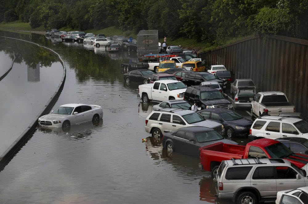 Vehicles left stranded on a flooded Interstate 45 in Houston, Texas on May 26, 2015. Heavy rains throughout Texas put the city of Houston under massive amounts of water, closing roadways and trapping residents in their cars and buildings, according to local reports. (Aaron M. Sprecher/AFP/Getty Images)