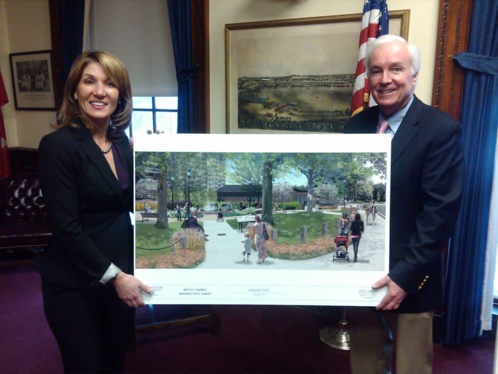 Mayor Michael McGlynn and Lt. Gov. Karyn Polito hold a photo of the Krystle Campbell Peace Garden. (Courtesy Lisa Evangelista)