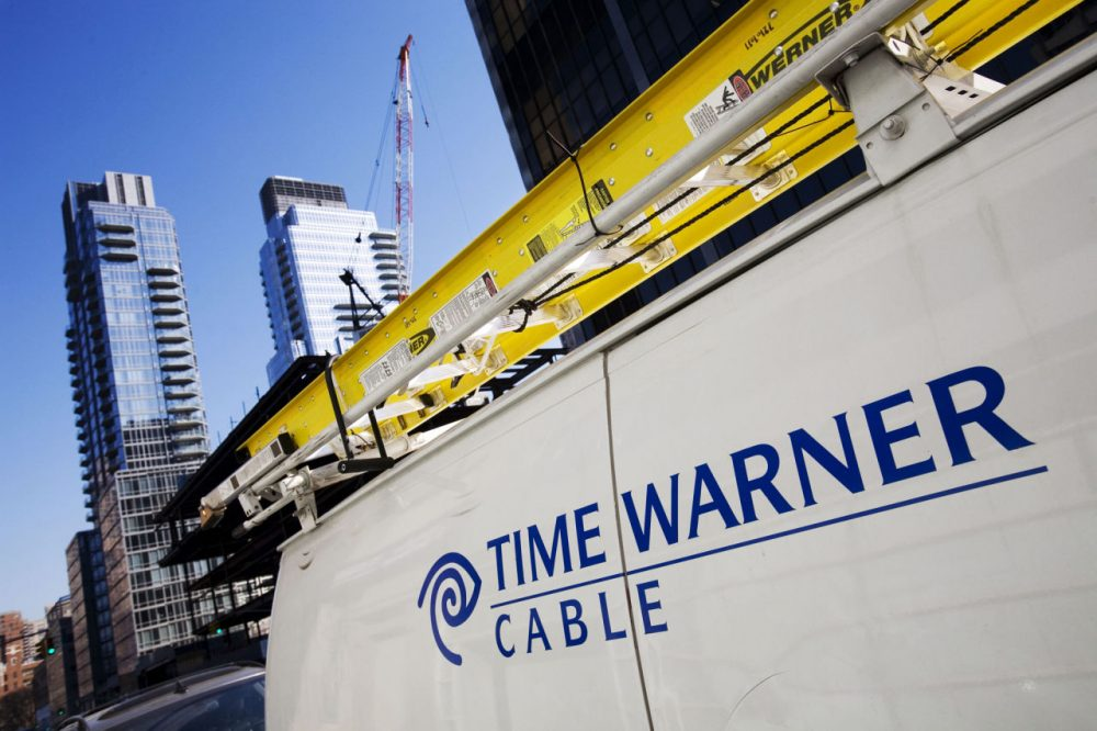 A Time Warner Cable truck is pictured in New York on Feb. 2, 2009. Charter Communications is close to buying Time Warner Cable. (Mark Lennihan/AP)