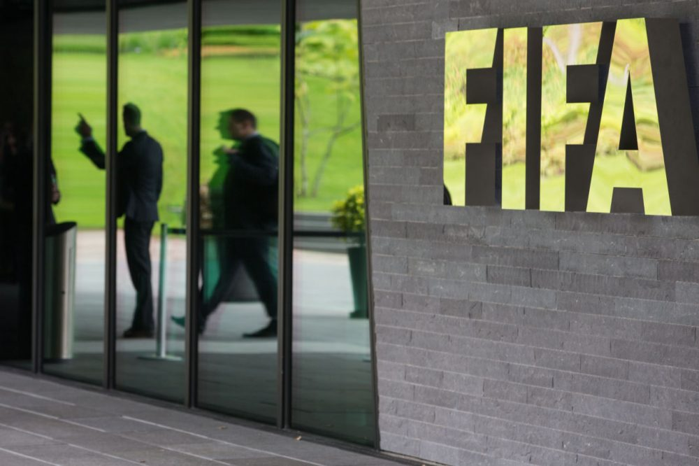 A FIFA logo sits next to the entrance to the FIFA headquarters on May 27, 2015 in Zurich, Switzerland. Swiss police on Wednesday raided a Zurich hotel to detain top FIFA football officials as part of a US investigation into corruption. (Philipp Schmidli/Getty Images)