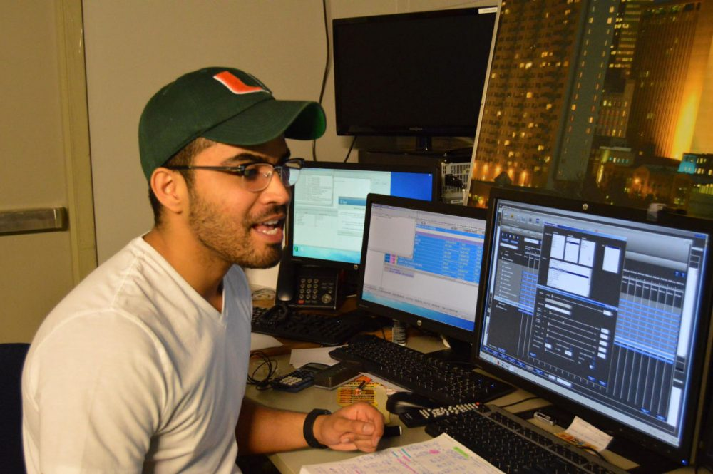 Meteorologist Jesus Lopez demonstrates some of the weather forecasting software at the Telemundo studios in Oklahoma City. (Jacob McCleland/KGOU)