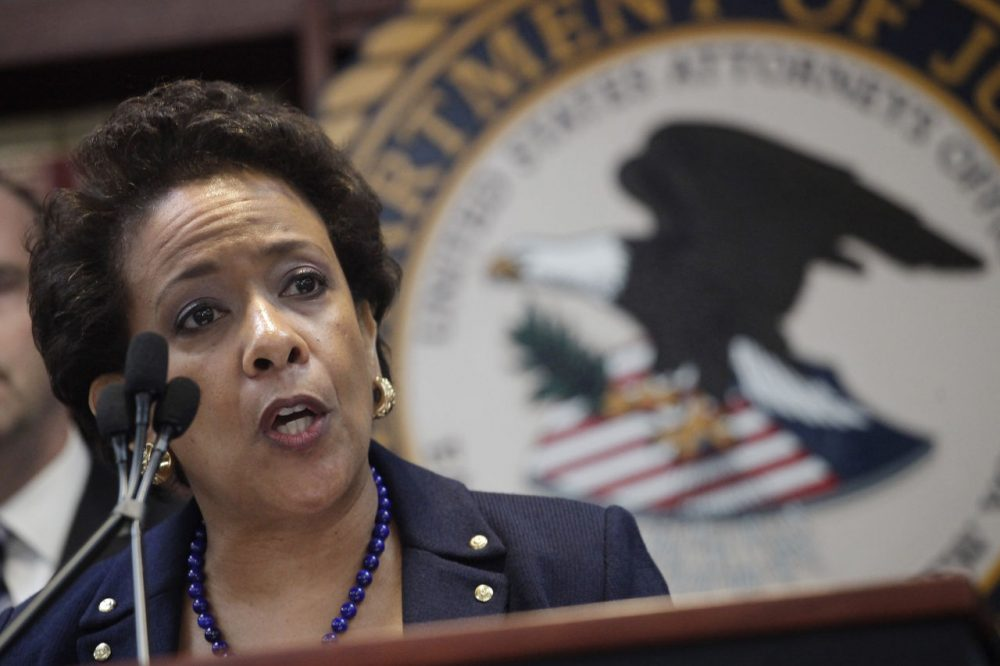 U.S. Attorney General Loretta Lynch announces an indictment against nine FIFA officials and five corporate executives for racketeering, conspiracy and corruption Wednesday. (Mark Lennihan/AP)
