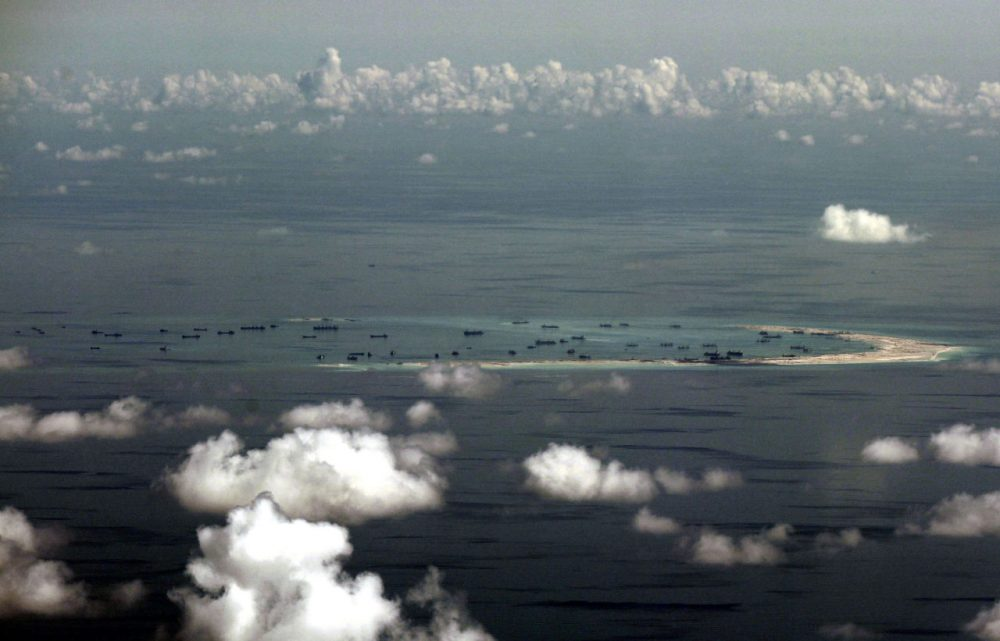 This areal photo taken through a glass window of a military plane shows China's alleged on-going reclamation of Mischief Reef in the Spratly Islands in the South China Sea Monday, May 11, 2015. (Ritchie B. Tongo/AP)
