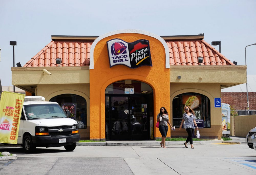Customers walk out of a Taco Bell and Pizza Hut restaurant during lunchtime on April 19, 2012 in Los Angeles, California. (Kevork Djansezian/Getty Images)