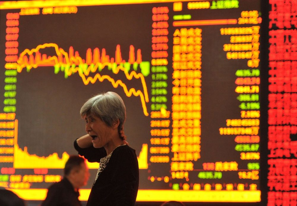 A stock investor gestures as she checks share prices at a security firm in Fuyang, east China's Anhui province on May 28, 2015. Chinese stocks plunged 6.5 percent on May 28 on concerns over tight liquidity and stricter requirements for margin trading, after closing at a more than seven-year high the previous day, dealers said. (STR/AFP/Getty Images)