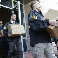 "Federal agents load a van with boxes of evidence taken from the headquarters of the Confederation of North, Central America and Caribbean Association Football (CONCACAF,) Wednesday, May 27, 2015, in Miami Beach, Fla. Swiss prosecutors opened criminal proceedings into FIFA's awarding of the 2018 and 2022 World Cups, only hours after seven soccer officials were arrested Wednesday pending extradition to the U.S. in a separate probe of ""rampant, systemic, and deep-rooted"" corruption. (Wilfredo Lee/AP)"