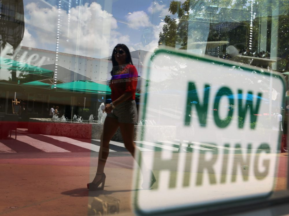 "A ""now hiring'' sign is seen in a storefront window on July 5, 2012 in Miami Beach, Florida. (Joe Raedle/Getty Images)"