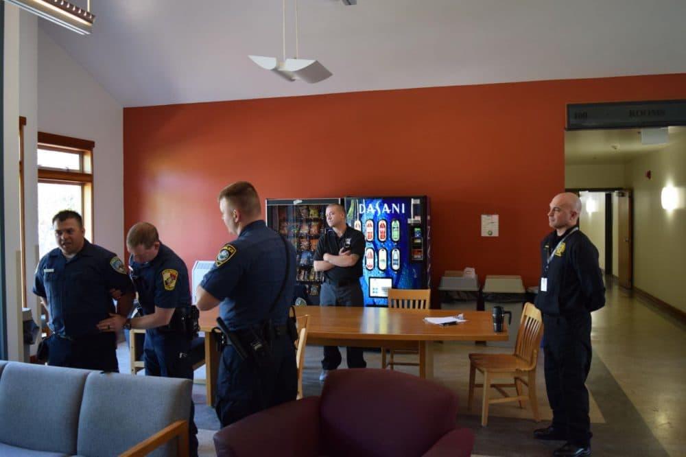 Instructor Russ Hicks looks on as recruits perform a mock arrest. (Rowan Moore Gerety/Northwest Public Radio)