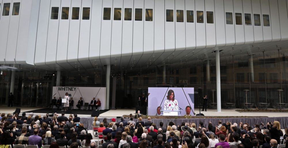 First lady Michelle Obama speaks from a podium outside the new $422 million Renzo Piano-designed Whitney Museum of American Art. (Bebeto Matthews/AP)