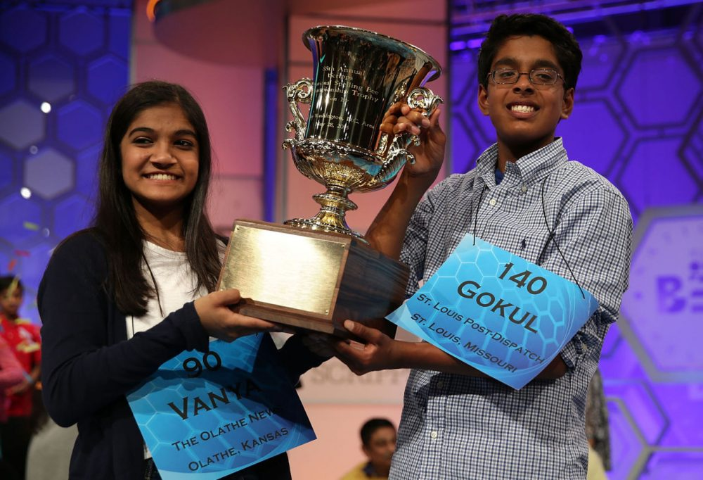 Vanya Shivashankar  (left) of Olathe, Kansas, and Gokul Venkatachalam (right) of St. Louis, Missouri, hold up the trophy after winning the 2015 Scripps National Spelling Bee May 28, 2015 in National Harbor, Maryland. Shivashankar and Venkatachalam were declared co-champions at the annual spelling competition. (Alex Wong/Getty Images)