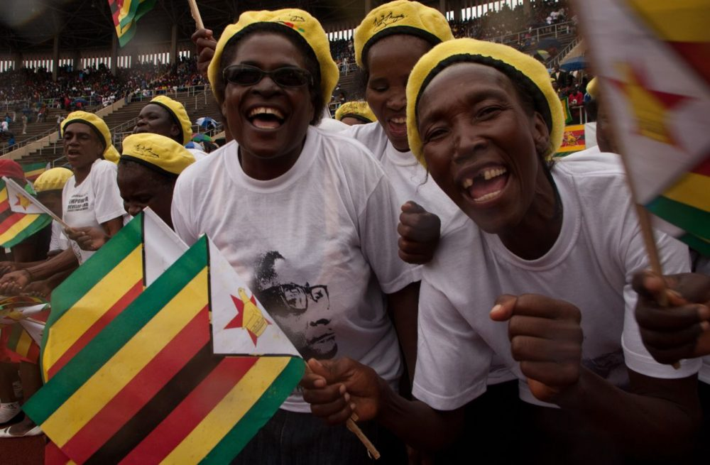 Supporters cheer during celebrations for Zimbabwe's 35th independence anniversary on April 18, 2015 in the capital, Harare, where President Robert Mugabe condemned ongoing anti-foreigner attacks in neighboring South Africa. (Jekesai Nijikizana/AFP/Getty Images)