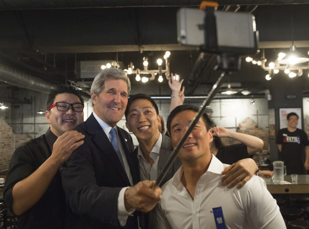 "US Secretary of State John Kerry uses a ""selfie stick"" during a stop at the restaurant in Seoul, on May 18, 2015. (Saul Loeb/AFP/Getty Images)"