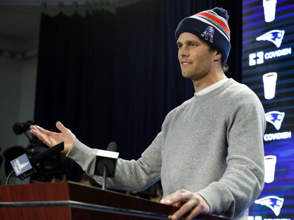 Patriots quarterback Tom Brady answers questions from the press back in January about allegations he used under-inflated footballs during the  team's AFC championship win against the Colts. (Elise Amendola/AP)