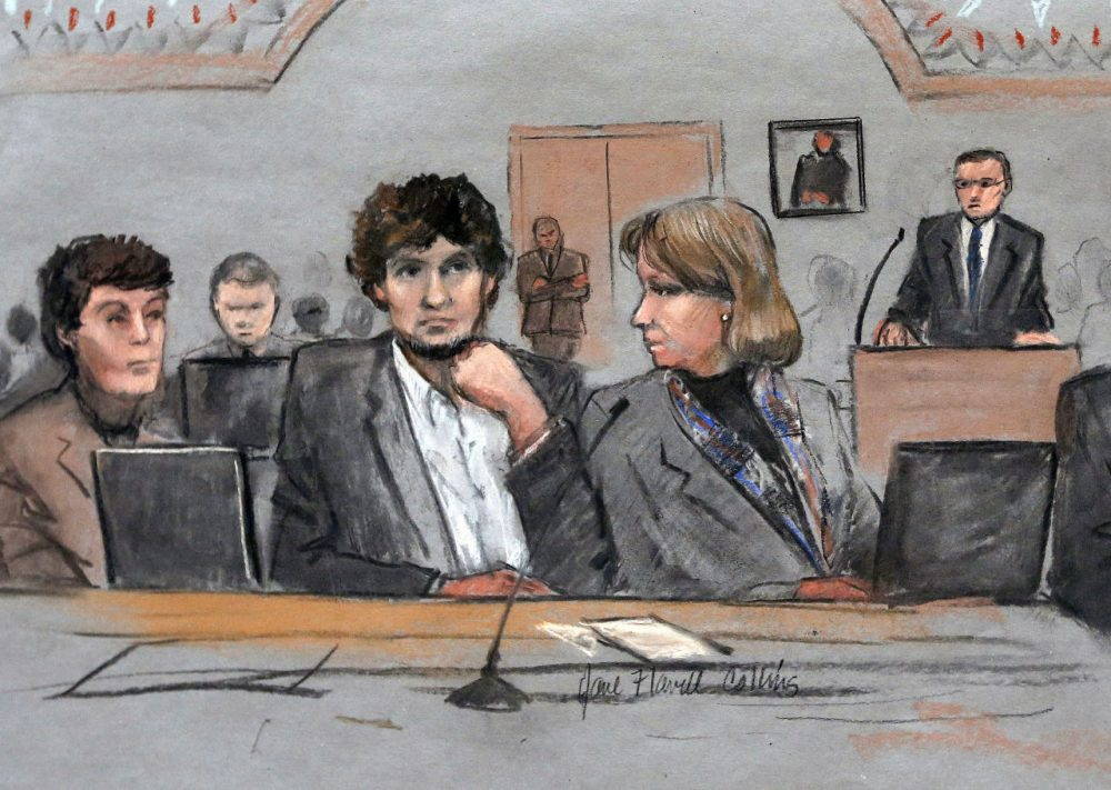 Dzhokhar Tsarnaev is depicted between defense attorneys Miriam Conrad, left, and Judy Clarke, right, during his federal death penalty trial, Thursday, March 5, 2015, in Boston. (Jane Flavell Collins/AP)