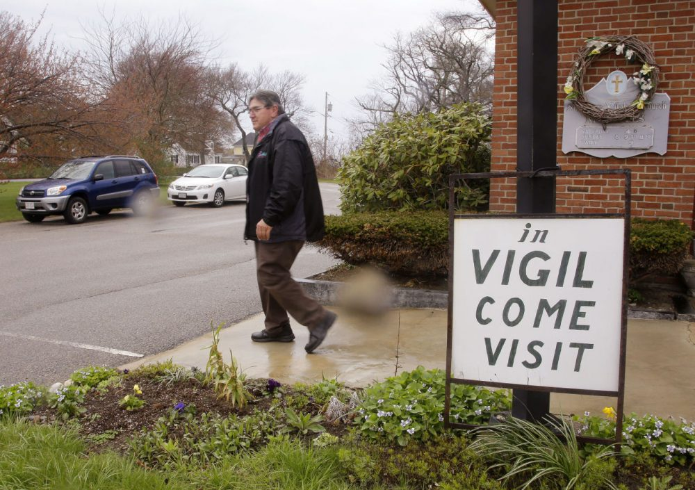 A parishioner who has been in vigil at St. Frances Xavier Cabrini Church for the past five years, leaves after his shift is over. (Stephan Savoia/AP)