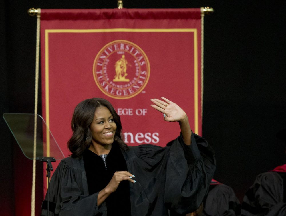 First lady Michelle Obama waves towards the crowd  just before she delivers the commencement address at Tuskegee University on Saturday.(Brynn Anderson/AP)