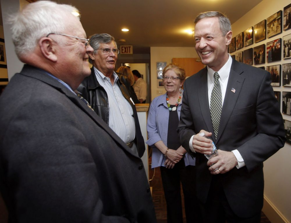 Former Maryland Gov. Martin O'Malley, right, talks with New Hampshire State Rep. Bob Backus, left, and former State Sen. Peter Burling before a private meeting with New Hampshire Democrats, Wednesday, May 13, 2015, in Concord, N.H. (Jim Cole/AP)