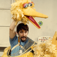 Archival photo of Caroll Spinney puppeteering Big Bird. (Courtesy Robert Furhing)