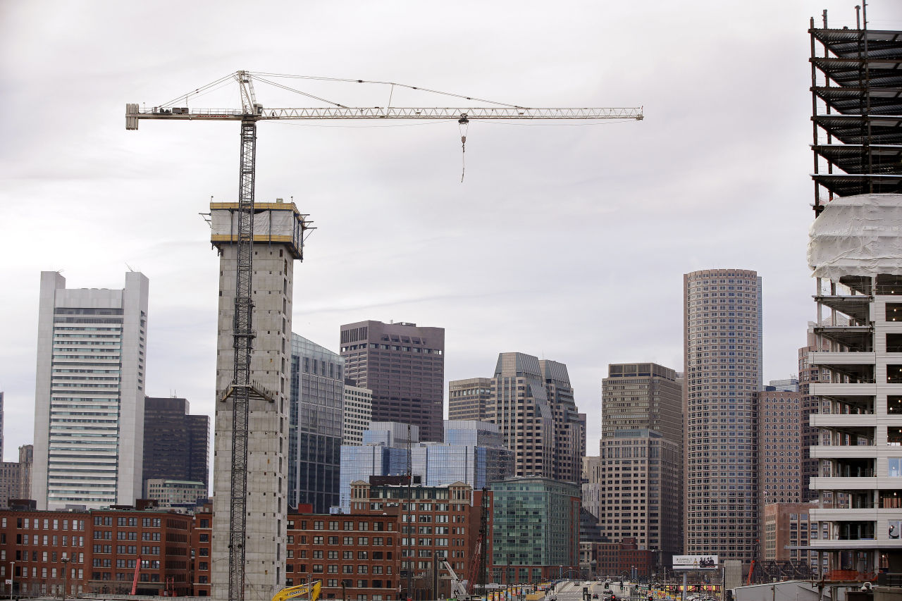 Several commercial construction projects in the Seaport district of Boston in 2014. (Stephan Savoia/AP)