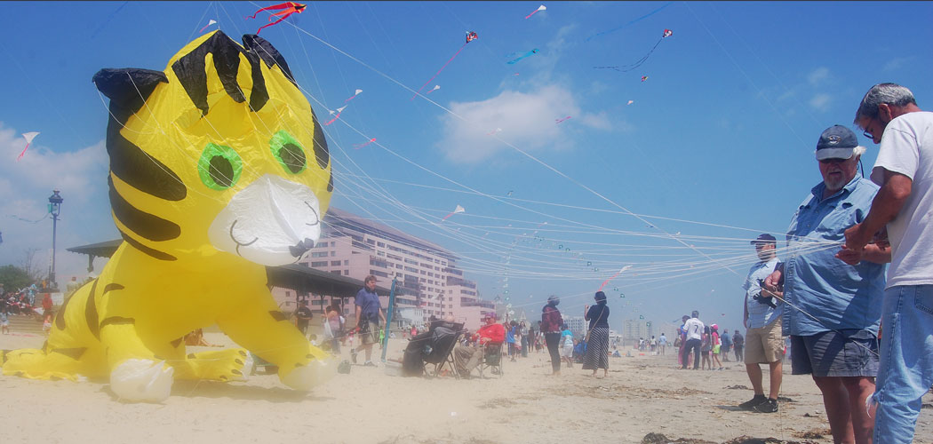Launching a tiger kite at the Revere Beach Kite Festival. (Greg Cook)