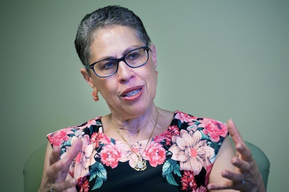 Former director of the Massachusetts Life Sciences Center Susan Windham-Bannister sitting at her desk in Waltham. (Jesse Costa/WBUR)
