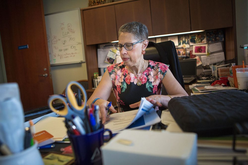 The outgoing director of the Massachusetts Life Sciences Center, Susan Windham-Bannister, sits at her desk in Waltham. (Jesse Costa/WBUR)