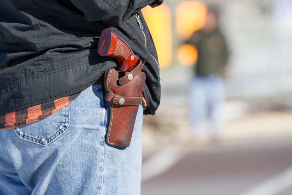 A woman wears her handgun in a holster. (weaverphoto/Flickr)