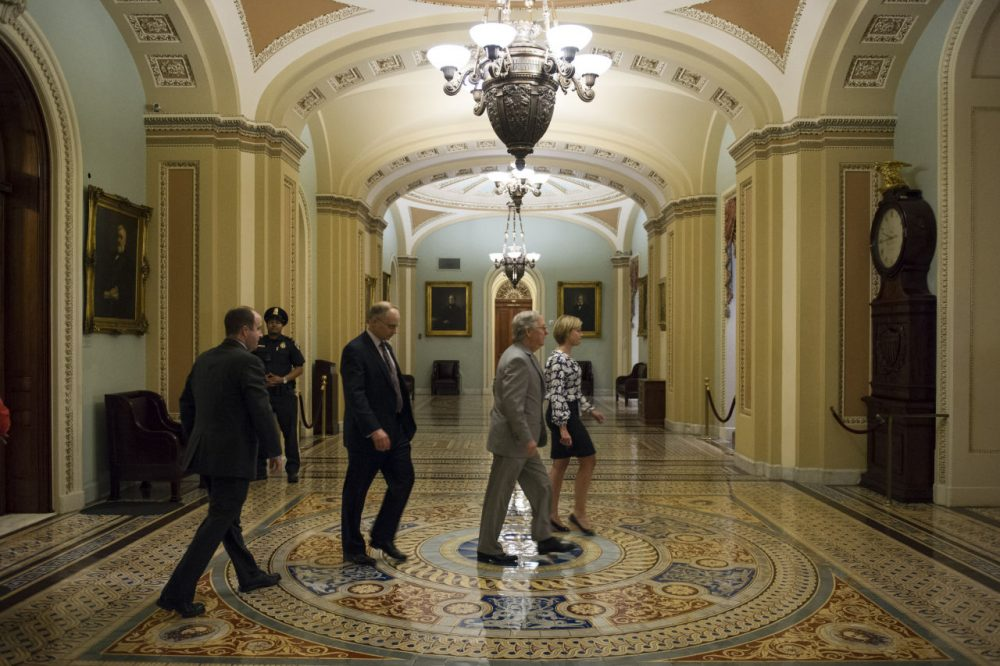 Senate Majority Leader Mitch McConnell, R-Ky., leaves the Senate Chamber after offering amendments to the USA Freedom act during a special session to extend surveillance programs on Sunday. (Cliff Owen/AP)