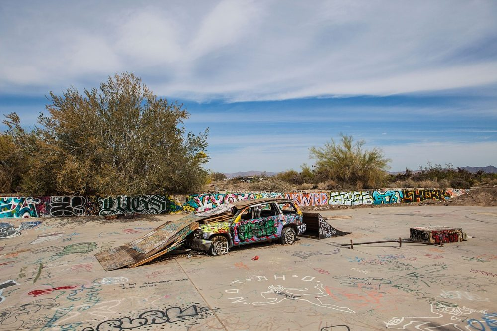 A car serves as the foundation for the Slab City skateboarding park, March 28, 2015. (Angela Carone)