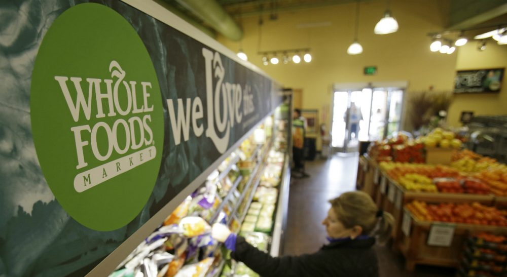 """The upscale grocer practices """"conscious capitalism,"""" but its workers and others still need programs like Obamacare. (Tony Dejak/AP)"""