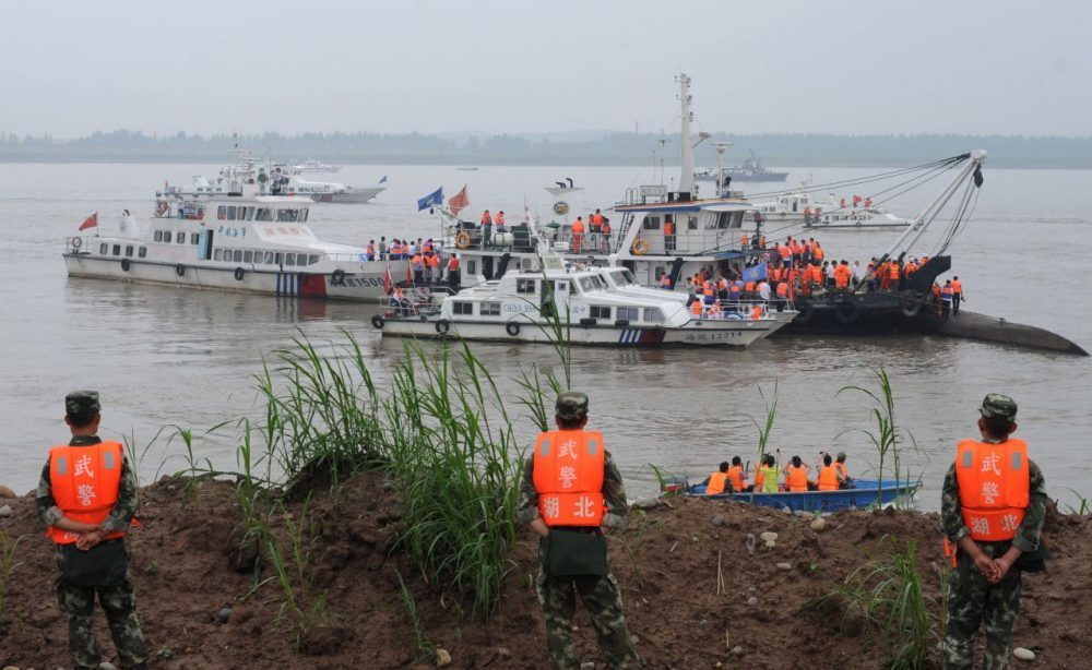 Rescue teams search for survivors near the Dongfangzhixing or 'Eastern Star' vessel which sank in the Yangtze river in Jianli, central China's Hubei province on June 2, 2015. Divers raced to find survivors on June 2 after a Chinese ship sank with more than 450 mainly elderly people in the storm-tossed Yangtze river, raising hopes more people can be found alive. (STR/AFP/Getty Images)